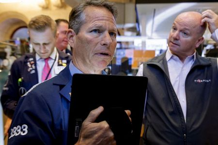 Wall Street's main indexes down on taper talk, earnings concerns